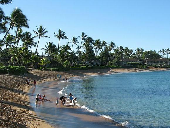 The Napili Kai Beach Resort, Maui, has a palm tree-lined, crescent-shaped beach.