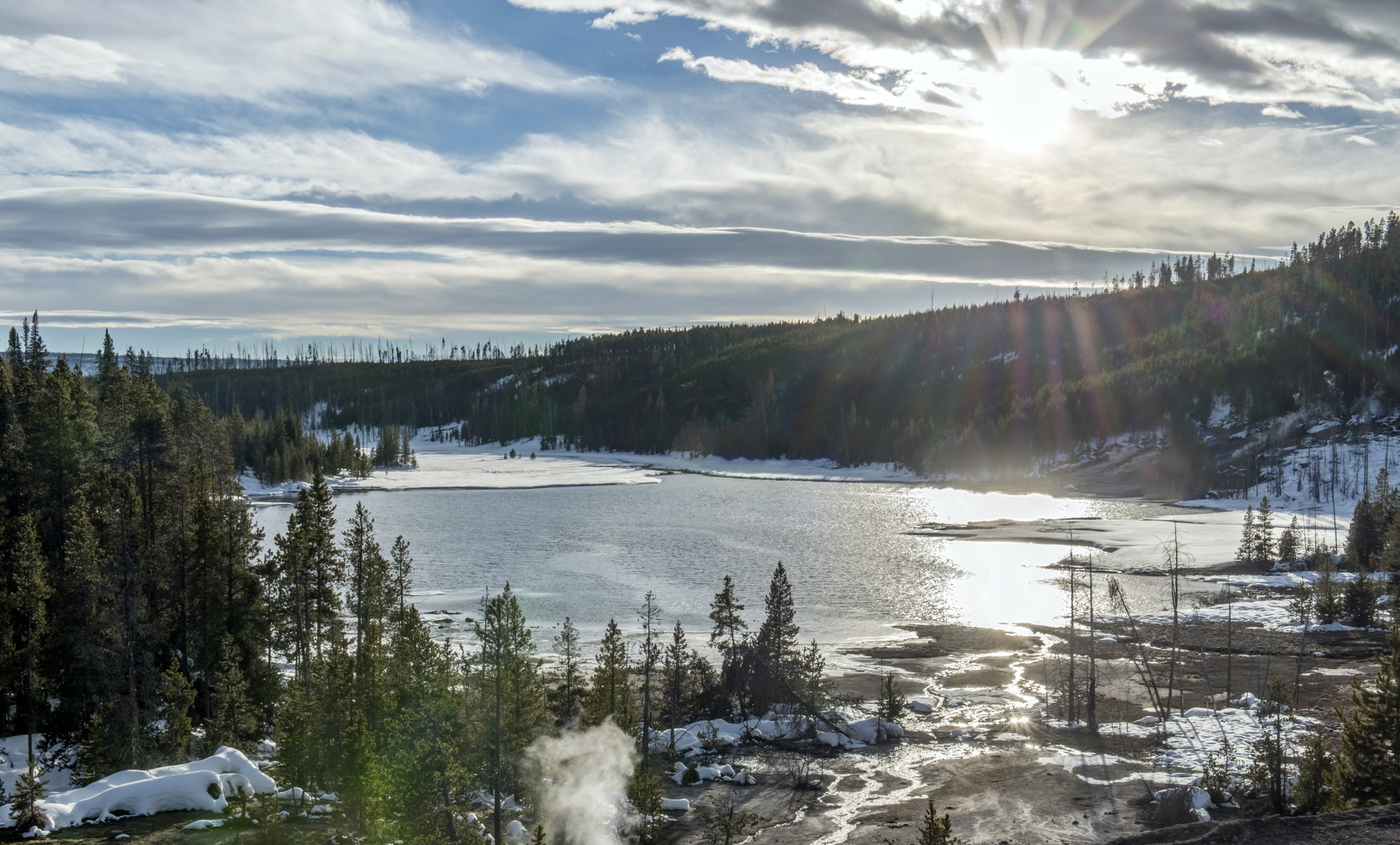 Aerial view of Yellowstone hot spring in winter, Wyoming, United States