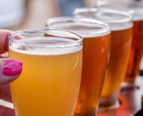 Beer flight on table at outdoor beer garden