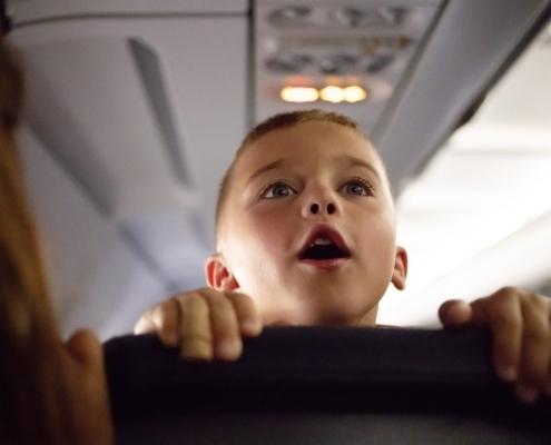 Kid on airplane talking