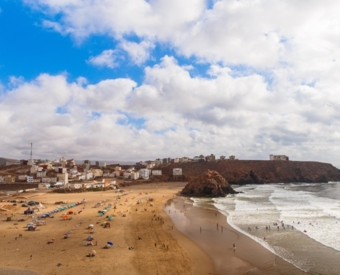Panoramic view on Atlantic ocean beach in small Morrocan town Iguer Ouzrou