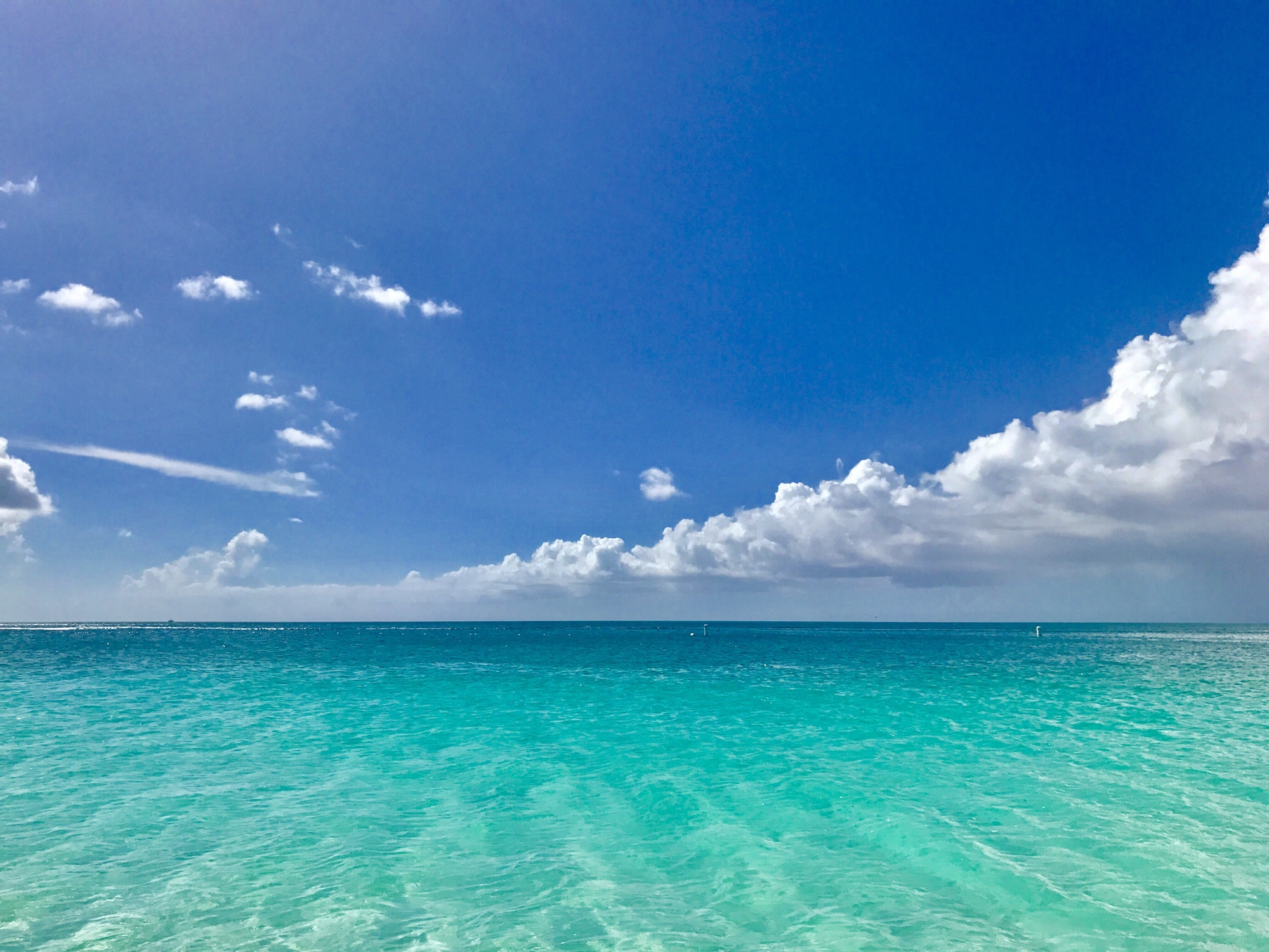 Turquoise water under the blue sky at Grace Bay, Turks and Caicos.
