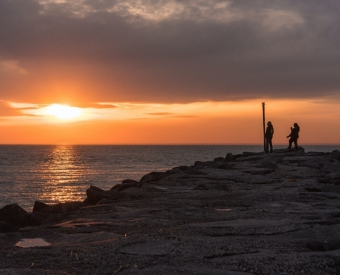 Taking in the sunset view at the end of a jetty along the Delaware River in Cape May, NJ.