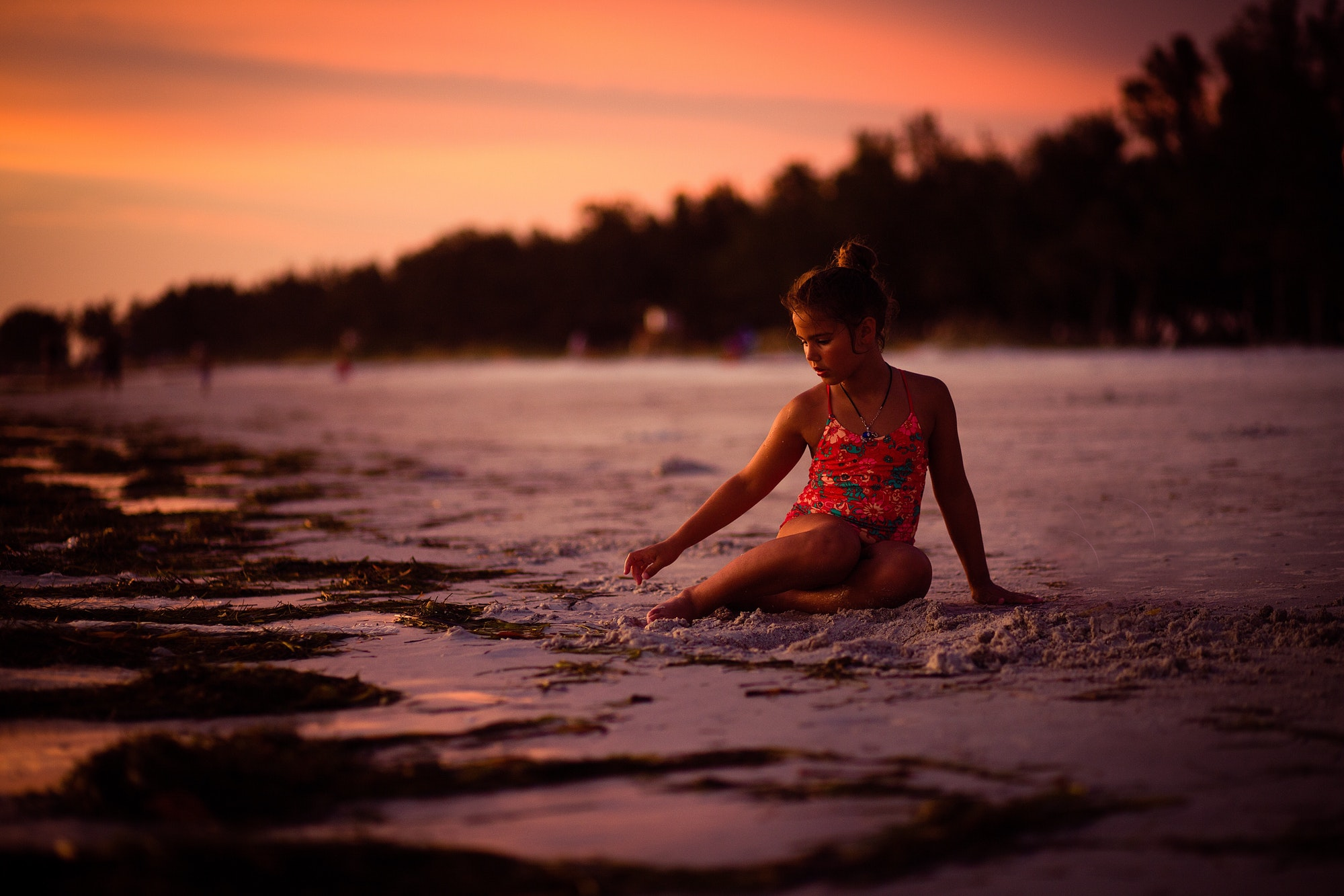 Young girl sitting on the beaches of Florida Siesta Keys